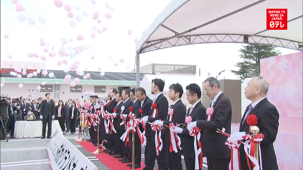 Fukushima town opens mall to welcome residents home