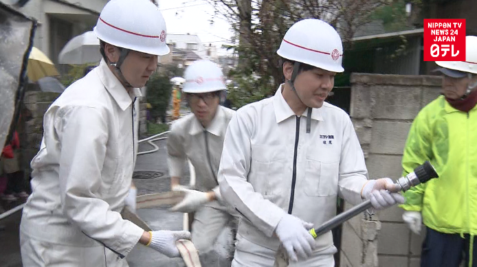 Tokyo firefighters drill in dense housing