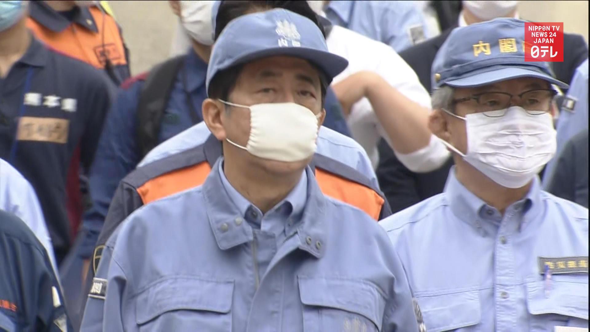 Japan PM vows aid to rain-battered Kumamoto