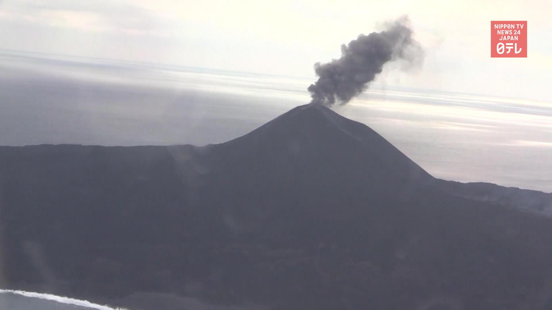 Volcanic island erupting and growing