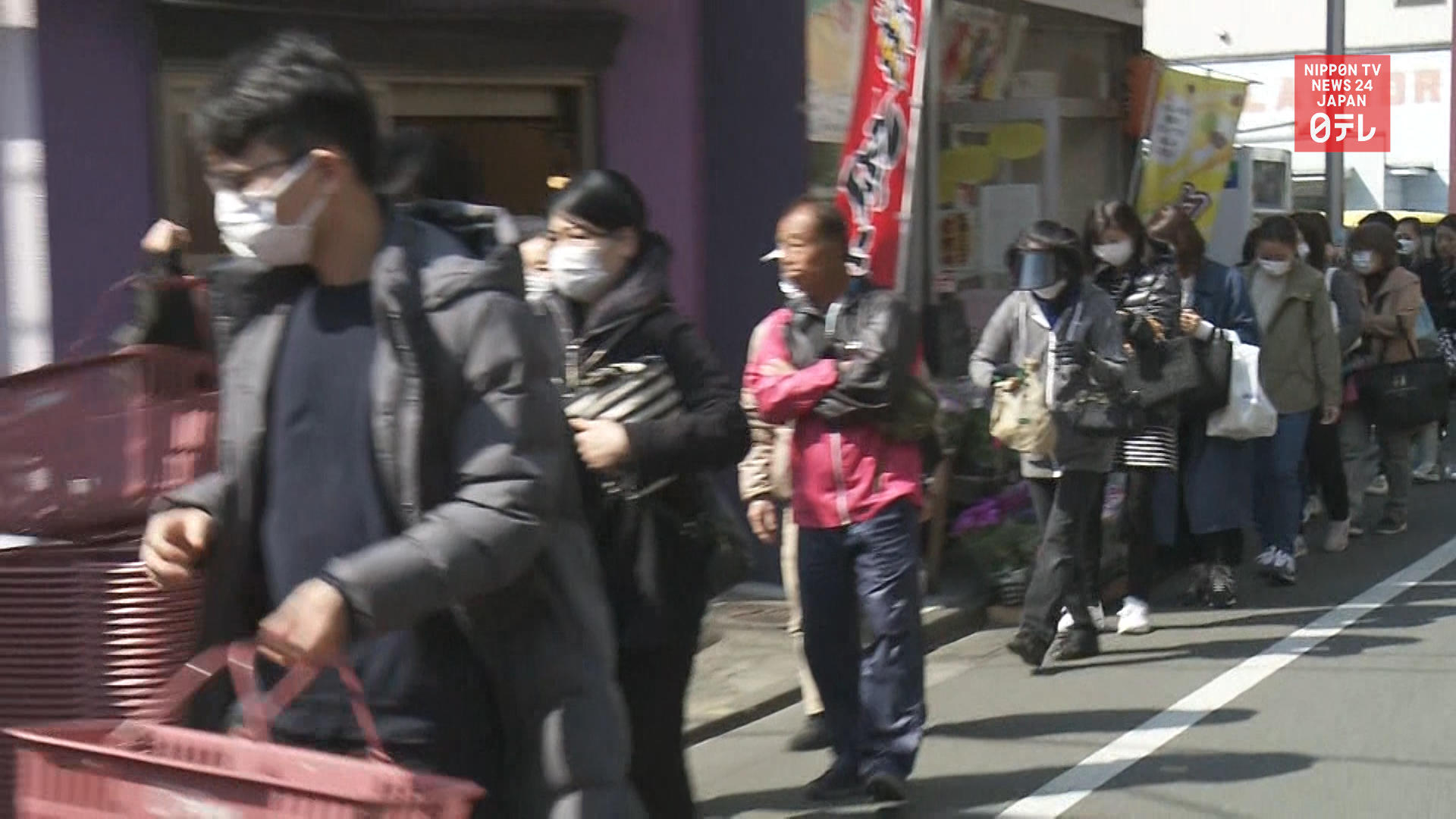 Tokyoites panic buy after governor's 'stay home' request