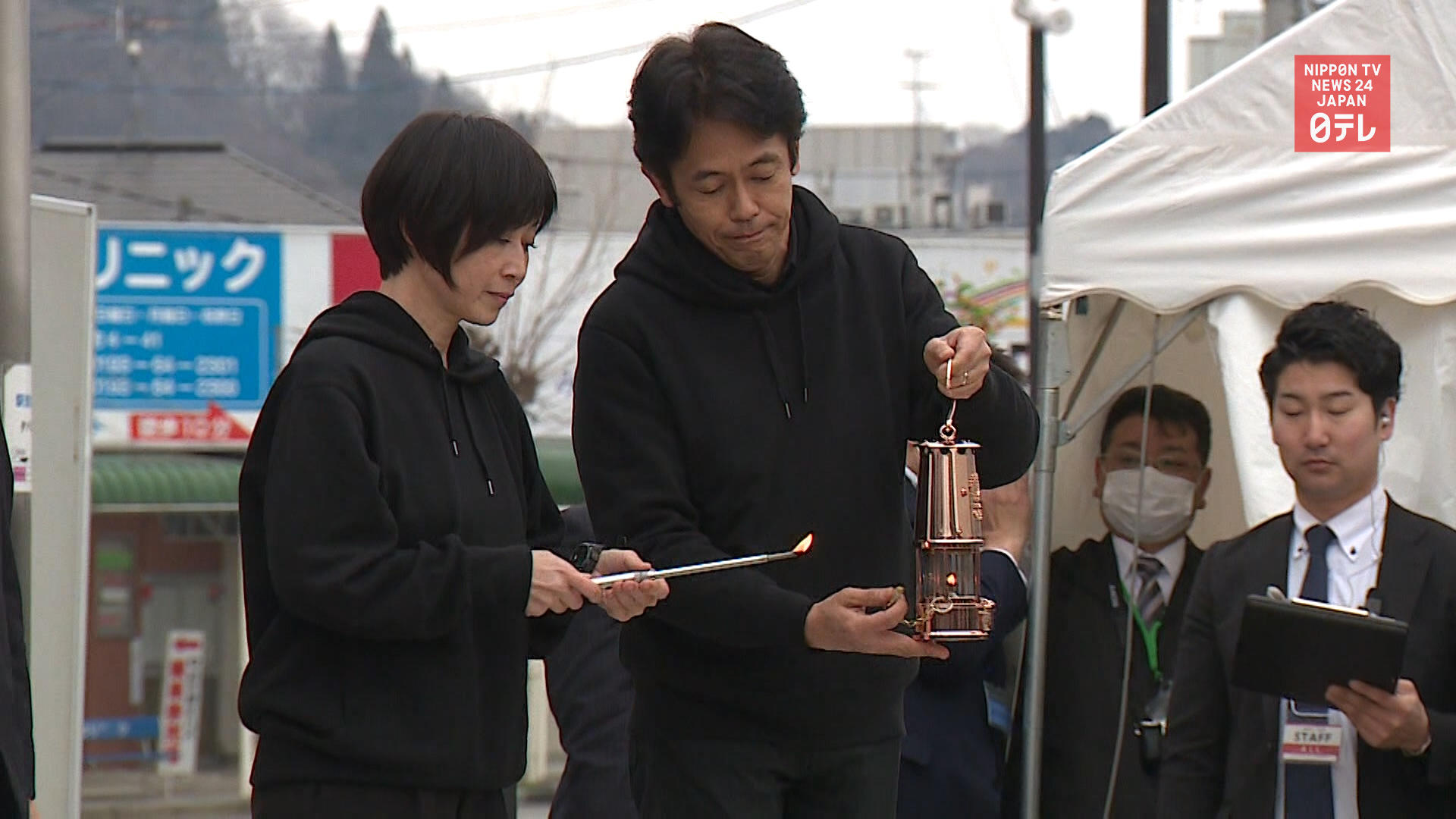 Japan to scale down Olympic torch relay to lantern tour