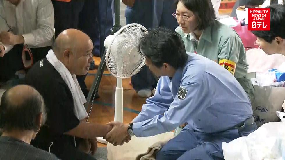 PM Abe visits flood-hit Okayama Prefecture