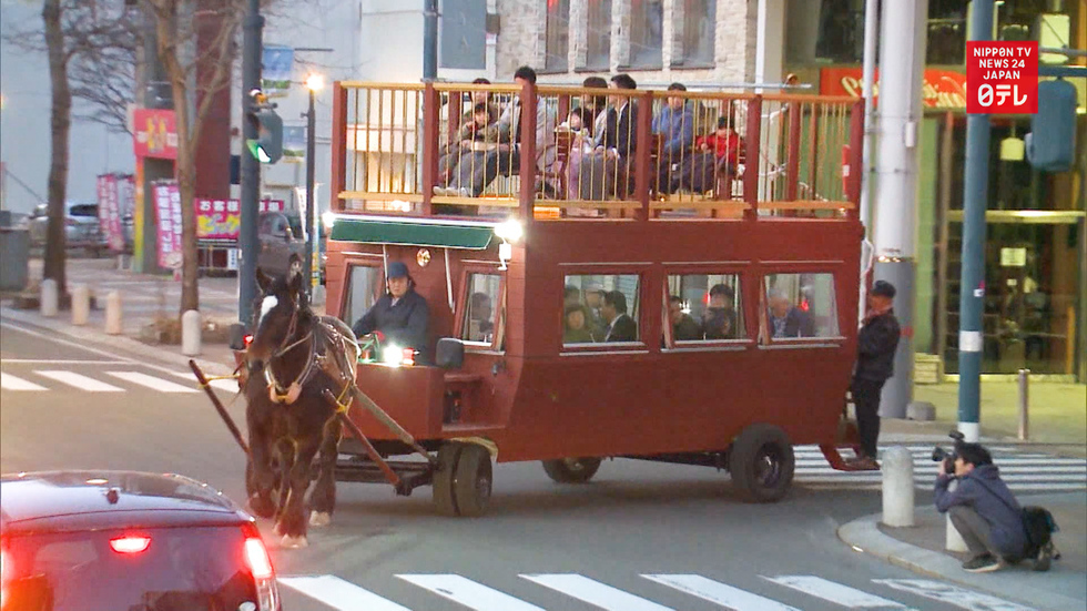 Horse-drawn bar wows town