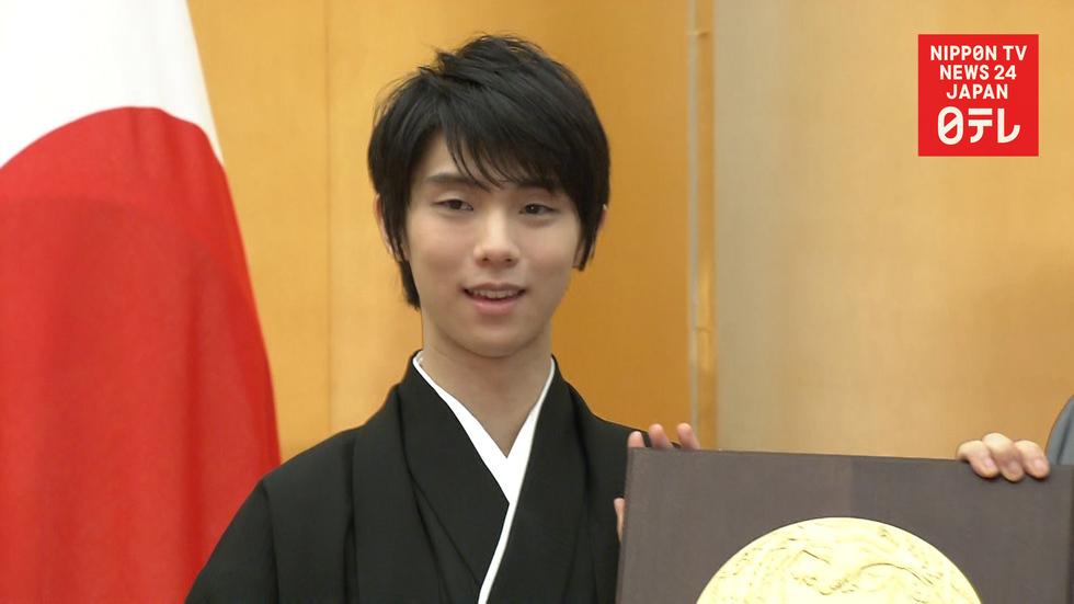 Skating champ Hanyu receives People's Honor Award