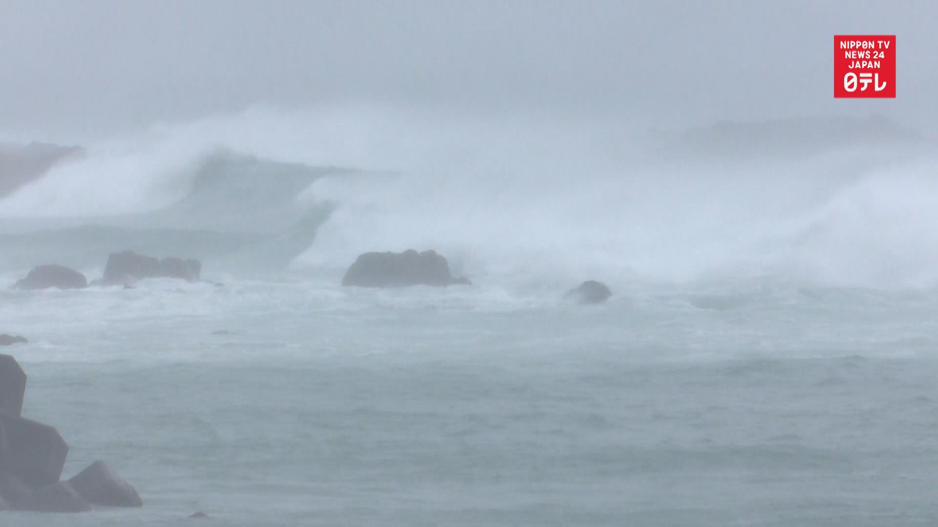Typhoon Krosa stops trains, planes