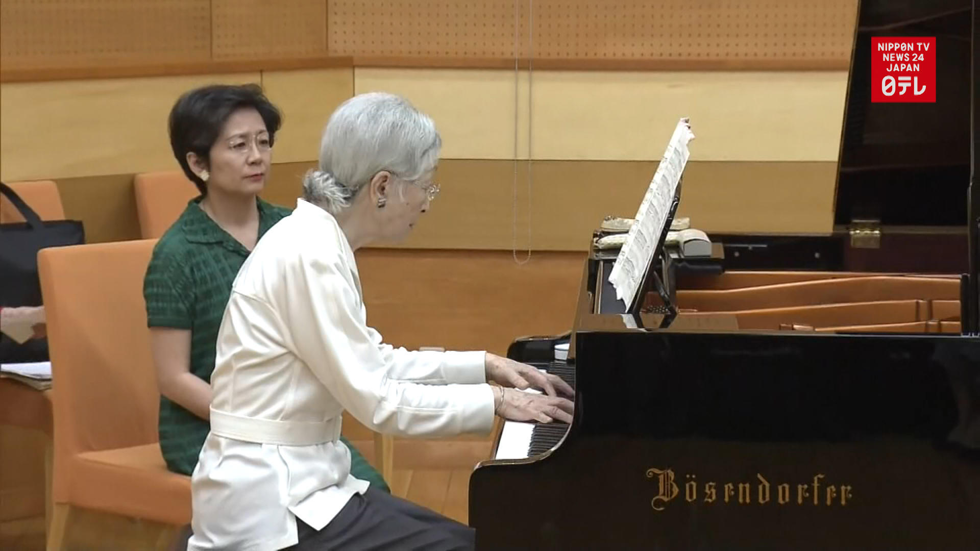 Empress Emerita plays the piano with Vienna Philharmonic flutist