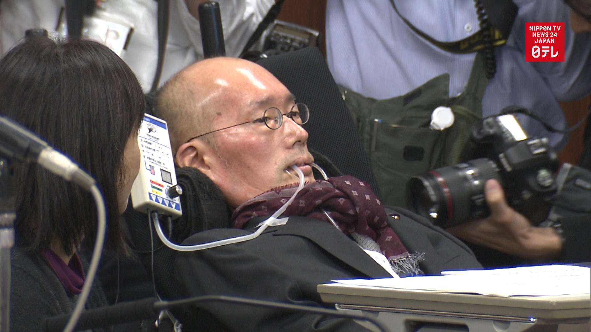 Lawmaker with ALS asks questions in Diet session