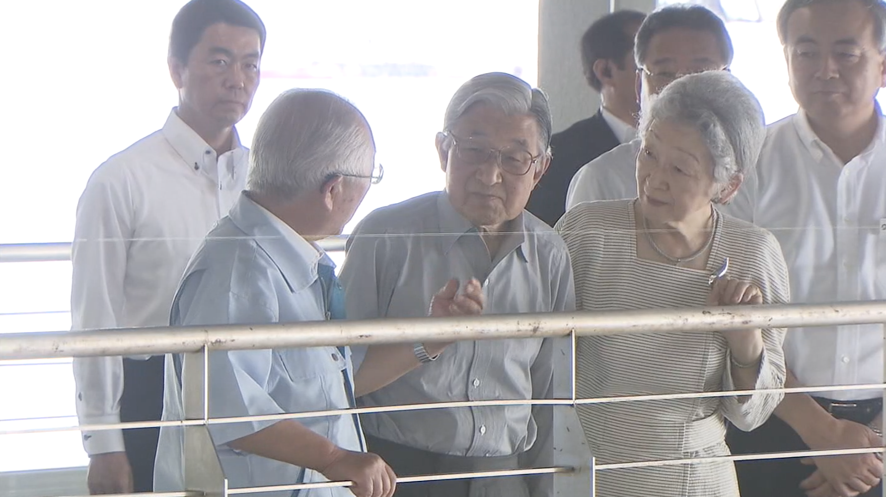 Imperial couple checks up on fishing port's post-tsunami recovery